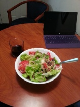 Making your own meals is almost always cheaper than eating out. And often tastes better, too. Here: organic butter lettuce, wild-caught tuna, avocado, tomatoes, olive oil, red wine vinegar, salt and pepper. The wine is a merlot from South Australia.