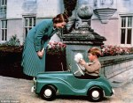 1952-Princess_Elizabeth_watches_her_son_Prince_Charles_playing_in_his-toy car